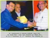 receiving-certificate-award-from-mr-harish-bhat-coo-titan-industries-ltd