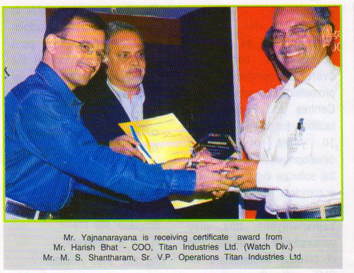 Receiving Certificate Award from Mr. Harish Bhat - COO, Titan Industries Ltd.